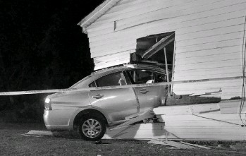 ?? Courtesy of Tamera Young ?? A photo taken at 3:52 a.m. on June 5th, 2021, by Galen Young's sister shows the damage sustained when a 2008 Mitsubishi Galant crashed through a window and into the house of Young's mother in Memphis, Tenn.