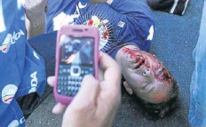 ?? Picture: ALON SKUY ?? VIOLENT SCENES: A DA marcher lies injured in Johannesburg yesterday.the DA was marching against Cosatu's blocking of the government youth wage subsidy. The subsidy is meant to benefit unemployed youth