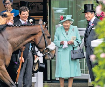 ??  ?? The Queen at the racecourse yesterday; Gusgurlach of Balmoral, left, the double champion at the Royal Highland Show Showcase