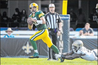 ?? The Associated Press ?? Phelan M. Ebenhack Packers quarterback Aaron Rodgers struggled against the Saints in Week 1, going just 15 of 28 for 133 yards with two interceptions and no TD passes.