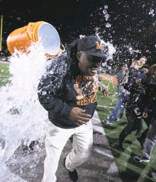?? D. Ross Cameron / Special to The Chronicle 2018 ?? McClymonds head coach Michael Peters gets a Gatorade shower after winning a section title in 2018.