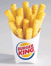 ?? © 2013 THE NEW YORK TIMES ?? An undated handout photo of Burger King's new French fries with less fat and calories, called 'Satisfries'.