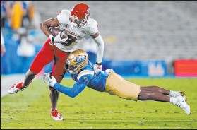 ?? Marcio Jose Sanchez The Associated Press ?? UCLA cornerback Cameron Johnson tries to tackle Fresno State wide receiver Ty Jones in the Bulldogs' 40-37 victory Saturday.