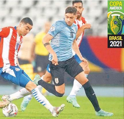 ??  ?? Justo. El combinado uruguayo necesitó de un gol para vencer a Paraguay y asegurar su pase a los cuartos de final.