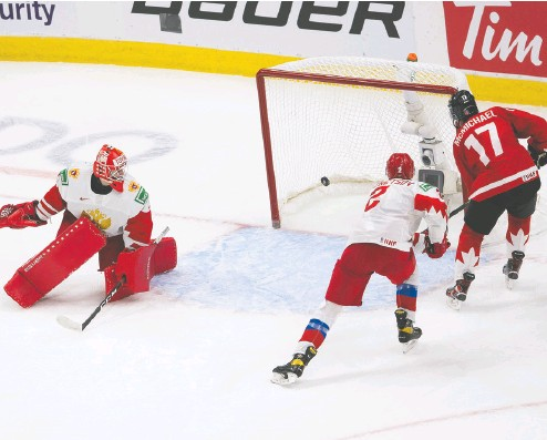 ?? Greg Southam / postmedia news ?? Connor Mcmichael scores on Russian goalie Yaroslav Askarov in Canada's win Monday night. Canada will face the