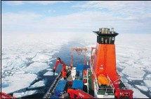 ?? Courtesy, Nicolas van Nieuwenhove ?? A research vessel cruises through melting sea ice northwest of Norway, where deep ocean currents are carrying warm water into the Arctic.