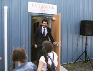 ??  ?? Chocolatier Tareq Hadhad greets children at the door of Peace By Chocolate's newly-opened factory in Antigonish.