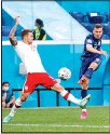 ?? Started the ?? Poland's Karol Linetty, (left), tries to block a shot from Slovakia's Lukas Haraslin during the Euro 2020 soccer championship Group E match between Poland v Slovakia at the Saint Petersburg Stadium in St. Petersburg, Russia. (AP)