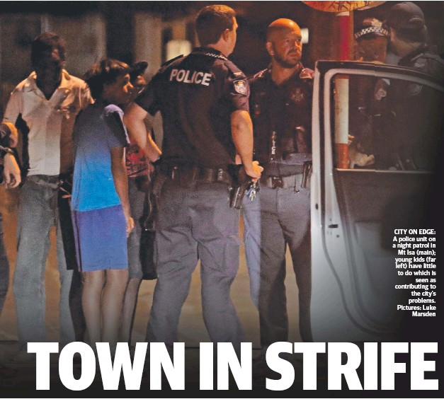 ??  ?? CITY ON EDGE: A police unit on a night patrol in Mt Isa (main); young kids (far left) have little to do which is seen as contributing to the city's problems. Pictures: Luke Marsden