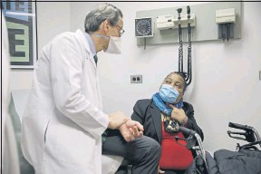 ?? MARSHALL RITZEL — THE ASSOCIATED PRESS ?? Trachea transplant recipient Sonia Sein talks with the lead surgeon of her procedure, Dr. Eric Genden, during a checkup visit at Mt. Sinai hospital in New York on March 22.